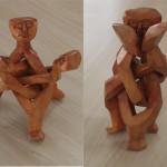 Representação dos processos grupais em escultura de madeira